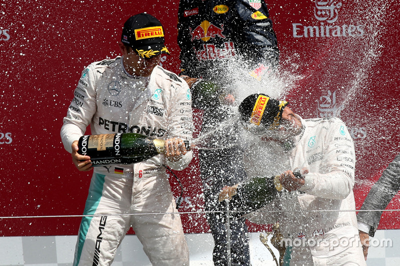The podium (L to R): Nico Rosberg, Mercedes AMG F1, second; Lewis Hamilton, Mercedes AMG F1, race winner; celebrate with champagne