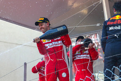 Race winner Sebastian Vettel, Ferrari, Kimi Raikkonen, Ferrari and Daniel Ricciardo, Red Bull Racing