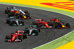 Sebastian Vettel, Ferrari SF70H leads at the start of the race as Kimi Raikkonen, Ferrari SF70H and Max Verstappen, Red Bull Racing RB13 collide