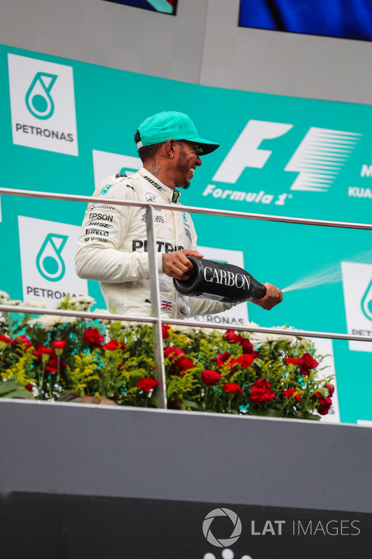Lewis Hamilton, Mercedes AMG F1 celebrates on the podium, the champagne