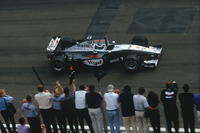 Mika Hakkinen,McLaren MP4/14 Mercedes-Benz, celebrates victory at the finish