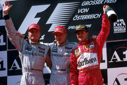 Podium: Race winner Mika Hakkinen, McLaren, second place David Coulthard, Mclaren, third place Michael Schumacher Ferrari
