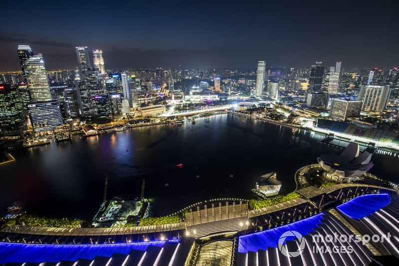 A scenic view of the Singapore skyline at night and the Marina Bay Formula 1 street circuit