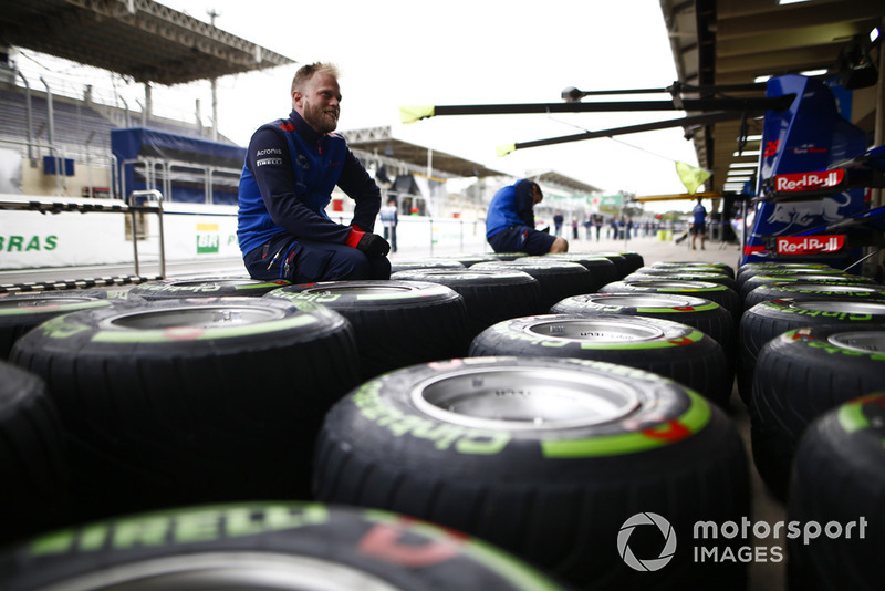A Toro Rosso mechanic works on Pirelli tyres