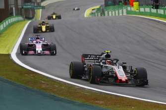Kevin Magnussen, Haas F1 Team VF-18, leads Sergio Perez, Racing Point Force India VJM11, and Carlos Sainz Jr., Renault Sport F1 Team R.S. 18