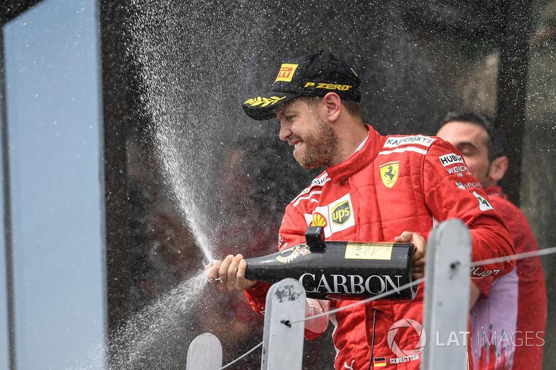 Sebastian Vettel, Ferrari celebrates on the podium with the champagne