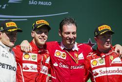 Second place Valtteri Bottas, Mercedes AMG F1, Race winner Sebastian Vettel, Ferrari, Giuseppe Vietina, Race Operations Manager, Ferrari, Third place Kimi Raikkonen, Ferrari, on the podium