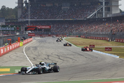 Valtteri Bottas, Mercedes AMG F1 W09, leads Kimi Raikkonen, Ferrari SF71H, and Max Verstappen, Red Bull Racing RB14