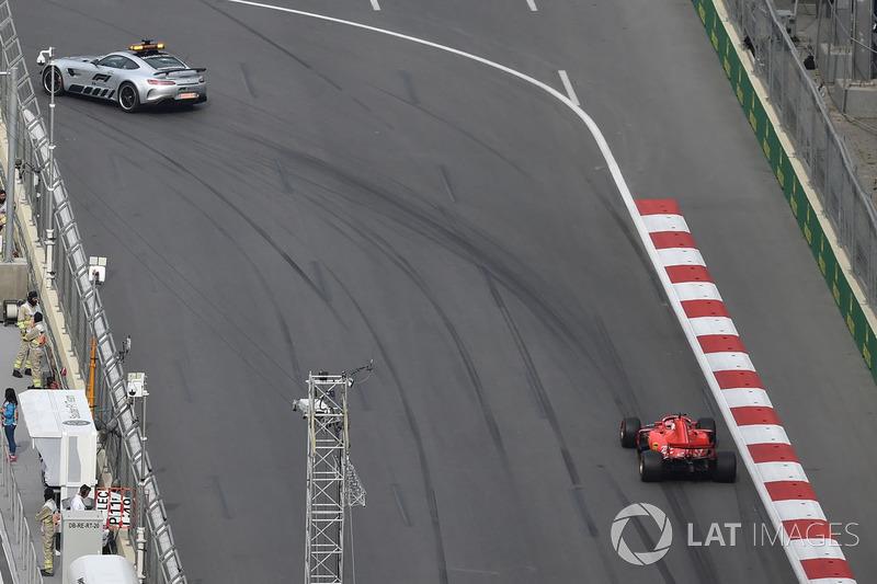 Safety car leads Sebastian Vettel, Ferrari SF71H