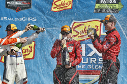 #99 JDC/Miller Motorsports ORECA 07, P: Stephen Simpson, Mikhail Goikhberg, Chris Miller, podium, champagne, #54 CORE autosport ORECA LMP2, P: Jon Bennett, Colin Braun, Romain Dumas
