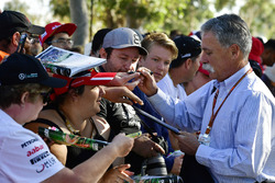 Chase Carey, Chief Executive Officer and Executive Chairman of the Formula One Group signs autographs for the fans