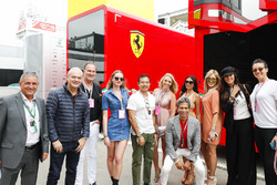 A group of VIP guests outside the Ferrari motorhome