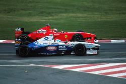 Michael Schumacher, Ferrari F300 laps Marc Gene, Minardi Ford M198