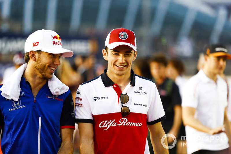 Charles Leclerc, Sauber, talks to Pierre Gasly, Toro Rosso