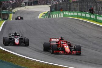 Sebastian Vettel, Ferrari SF71H, leads Romain Grosjean, Haas F1 Team VF-18