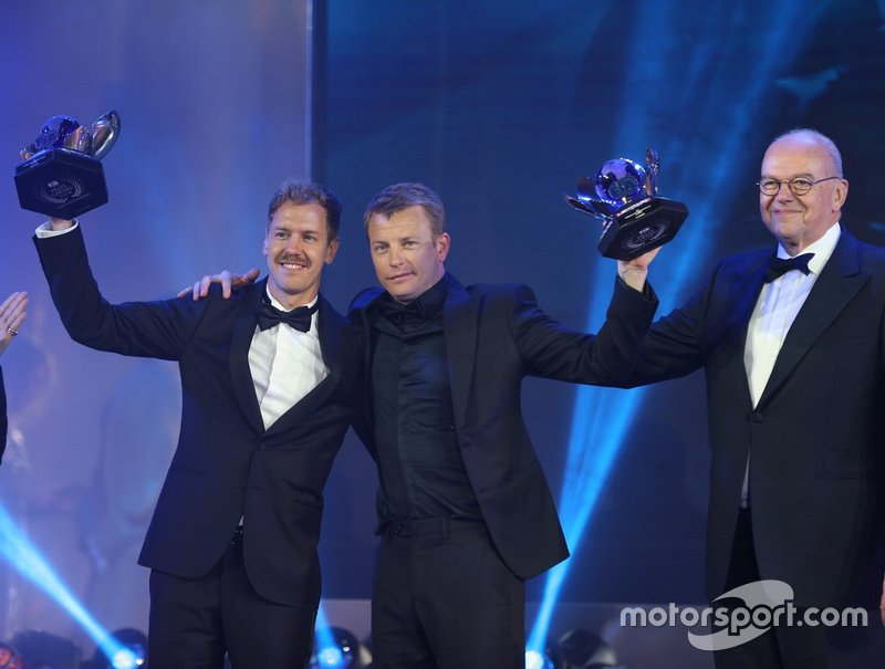 FIA Formula 1 World Championship for Drivers: Sebastian Vettel and Kimi Räikkönen with their runner up trophies