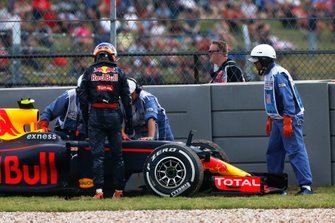Max Verstappen, Red Bull Racing RB12, climbs from his broken car