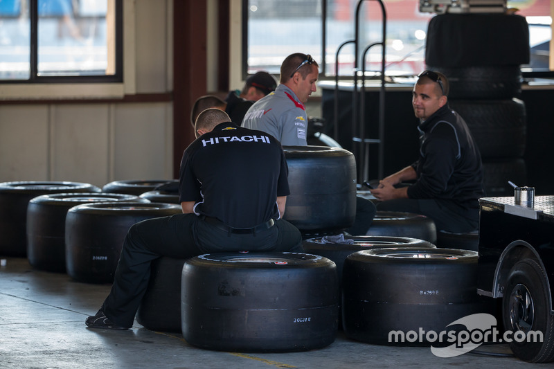 Penske engineers with tires