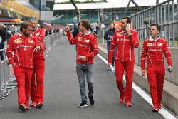 Sebastian Vettel, Ferrai, Maurizio Arrivabene, Ferrari Team Principal, Gino Rosato, Ferrari e Riccardo Adami, Ferrari Race Engineer