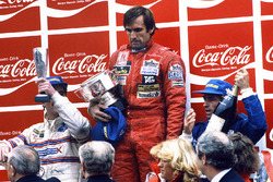 Podium: race winner Carlos Reutemann, Williams, second place Jacques Laffite, Talbot Ligier Matra, third place Nigel Mansell, Team Lotus