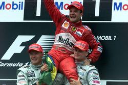 Podium: Race winner Rubens Barrichello, Ferrari, second place Mika Hakkinen, McLaren Mercedes, third