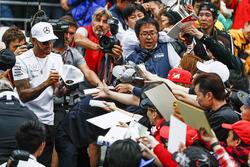 Lewis Hamilton, Mercedes AMG F1, signs an autograph