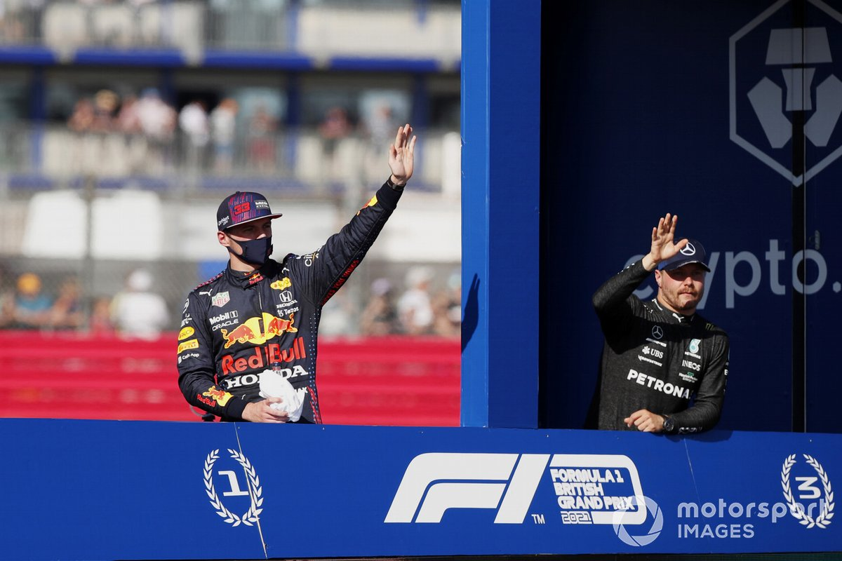 Max Verstappen, Red Bull Racing, 1st position, and Valtteri Bottas, Mercedes, 3rd position, tour the circuit in the victory lap truck after Sprint Qualifying