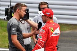 Sebastian Vettel, Ferrari talks with Jenson Button, in parc ferme