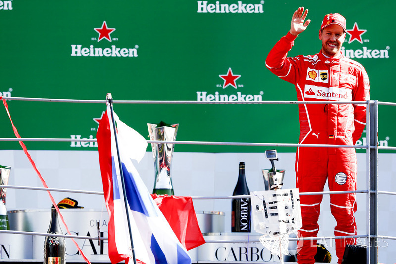 Third place Sebastian Vettel, Ferrari, on the podium