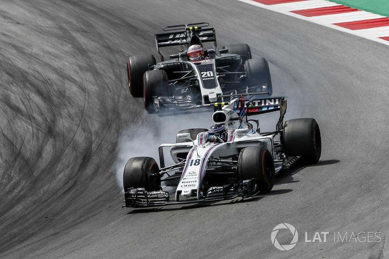 Ленс Стролл (Williams FW40) і Кевін Магнуссен (Haas F1 Team VF-17)