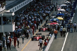 The Ferrari F186's of Michele Alboreto and Stefan Johansson, make their way down the pit lane