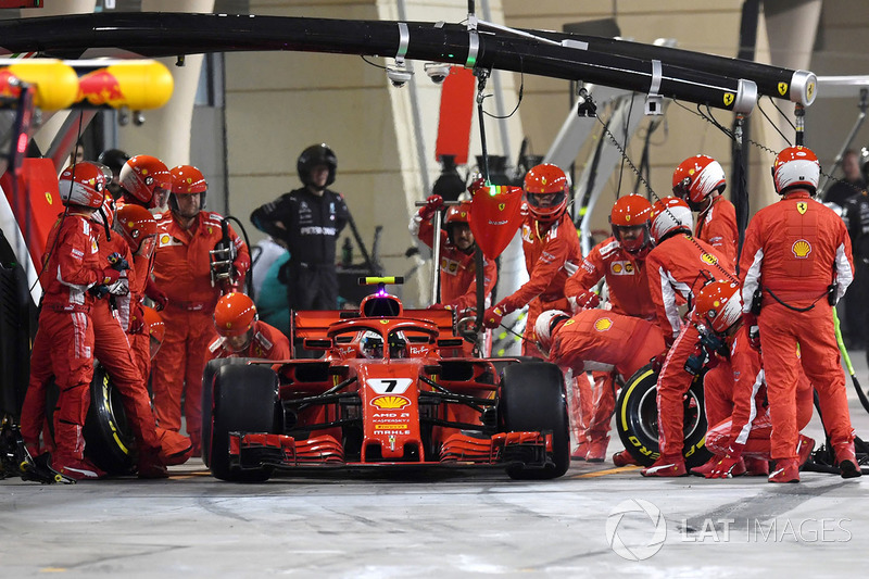 Kimi Raikkonen, Ferrari SF71H hits a mechanic as he leaves the pits