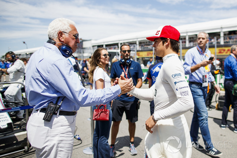 Lawrence Stroll wishes good luck to his son Lance Stroll, Williams Racing, on the grid