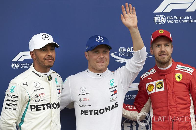 Le poleman Valtteri Bottas, Mercedes AMG F1, deuxième place Lewis Hamilton, Mercedes AMG F1, troisième place Sebastian Vettel, Ferrari