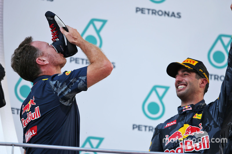 (L to R): Christian Horner, Red Bull Racing Team Principal celebrates on the podium by drinking cham
