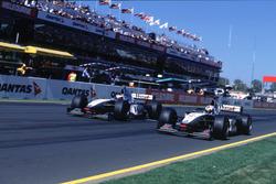 Mika Hakkinen, McLaren Mercedes passes David Coulthard, McLaren