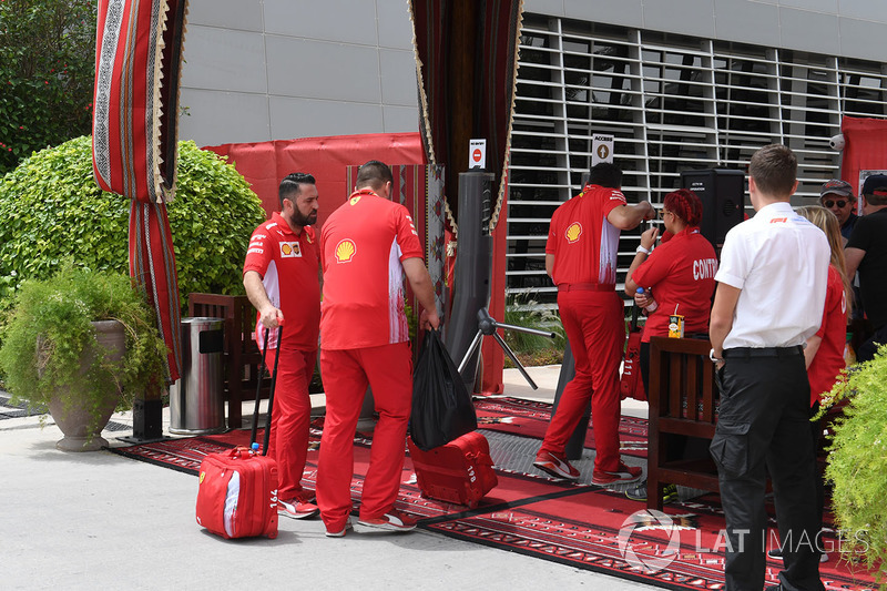 Ferrari personel at the Paddock gates