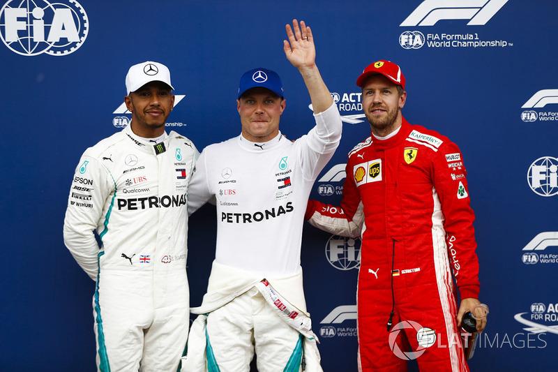 Pole sitter Valtteri Bottas, Mercedes AMG F1, second place Lewis Hamilton, Mercedes AMG F1, third place Sebastian Vettel, Ferrari
