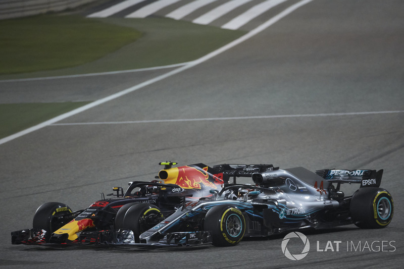 Lewis Hamilton, Mercedes AMG F1 W09, and Max Verstappen, Red Bull Racing RB14 Tag Heuer, make contac