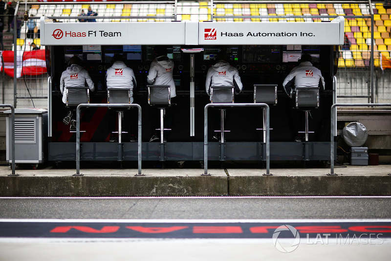 The Haas F1 management team on the pit wall