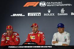 Polesitter Sebastian Vettel, Ferrari, second place Kimi Raikkonen, Ferrari, third place Valtteri Bottas, Mercedes AMG F1 in the Press Conference