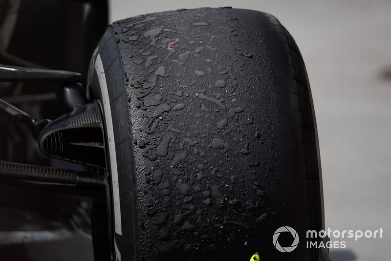 Worn tyre on the car of Lewis Hamilton, Mercedes AMG F1 W10, 1st position, after the race