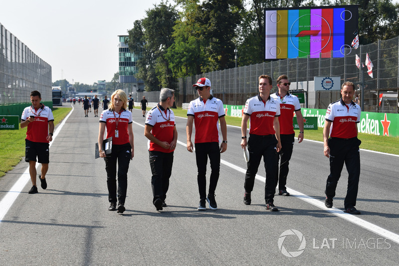 Charles Leclerc, Sauber walks the track and Ruth Buscombe, Sauber Race Strategist