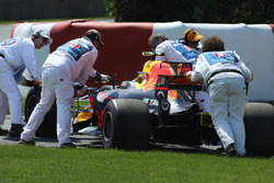 Marshals remove the car of Max Verstappen, Red Bull Racing RB13, from the circuit after he retired, technical issues