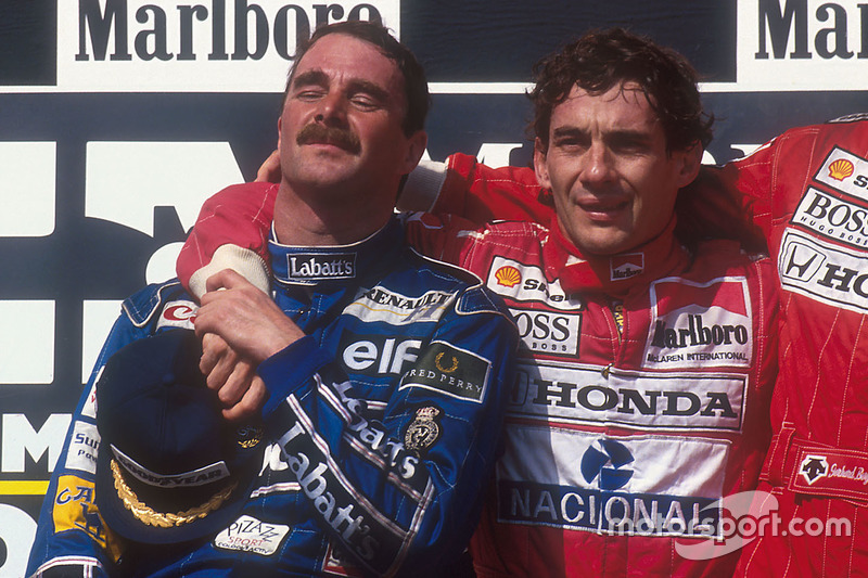 Podium: second place and world champion Nigel Mansell, Williams Renault, race winner Ayrton Senna, M