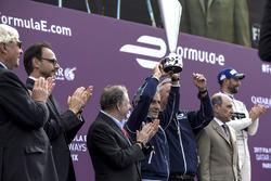 Alain Prost celebrates on the podium