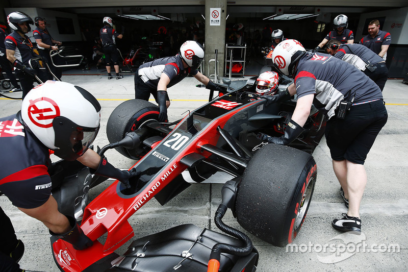 Kevin Magnussen, Haas F1 Team, is pushed into his pit garage in the pit lane