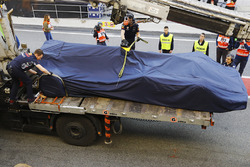 The Red Bull Racing RB13 TAG Heuer of Daniel Ricciardo is brought back to the garage  under covers on the rear of a truck