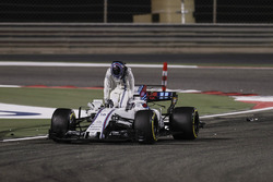 Lance Stroll, Williams FW40, climbs out of his damaged car after a collision with Carlos Sainz Jr., Scuderia Toro Rosso