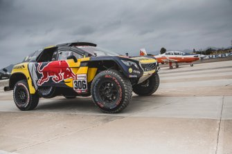 Sebastien Loeb and Daniel Elena of PH Sport make a race with an airplane before the Rally Dakar